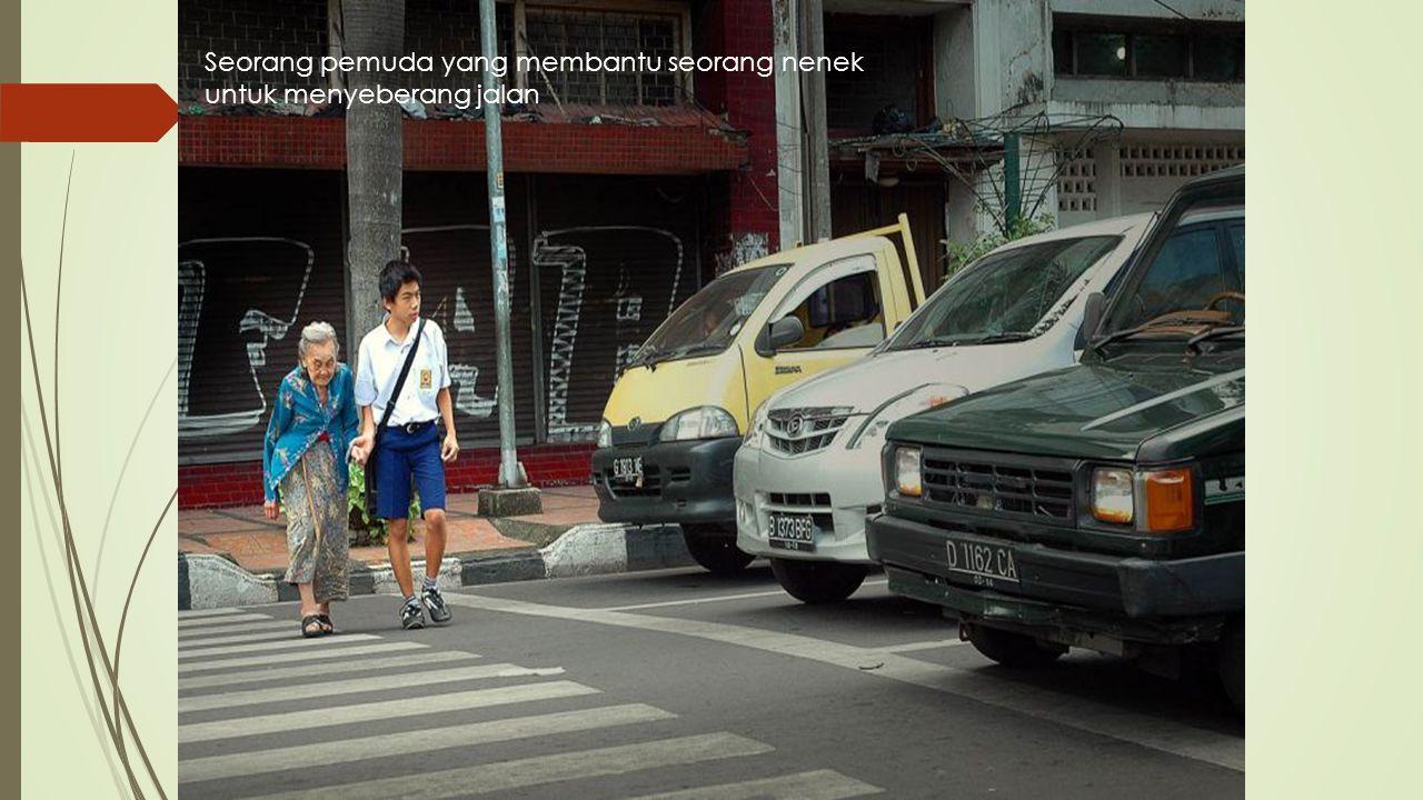 Seorang pemuda yang membantu seorang nenek untuk menyeberang jalan