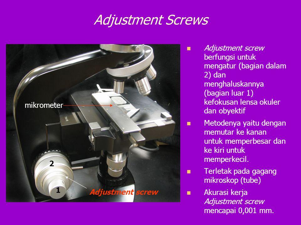 Adjustment Screws Adjustment screw berfungsi untuk mengatur (bagian dalam 2) dan menghaluskannya (bagian luar 1) kefokusan lensa okuler dan obyektif M