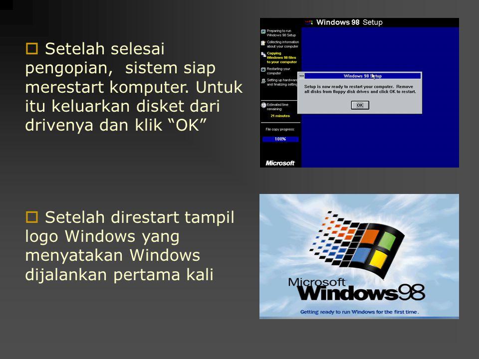 """ Setelah selesai pengopian, sistem siap merestart komputer. Untuk itu keluarkan disket dari drivenya dan klik """"OK""""  Setelah direstart tampil logo Wi"""