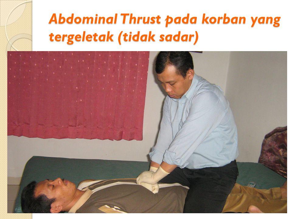 Abdominal Thrust pada korban yang tergeletak (tidak sadar)