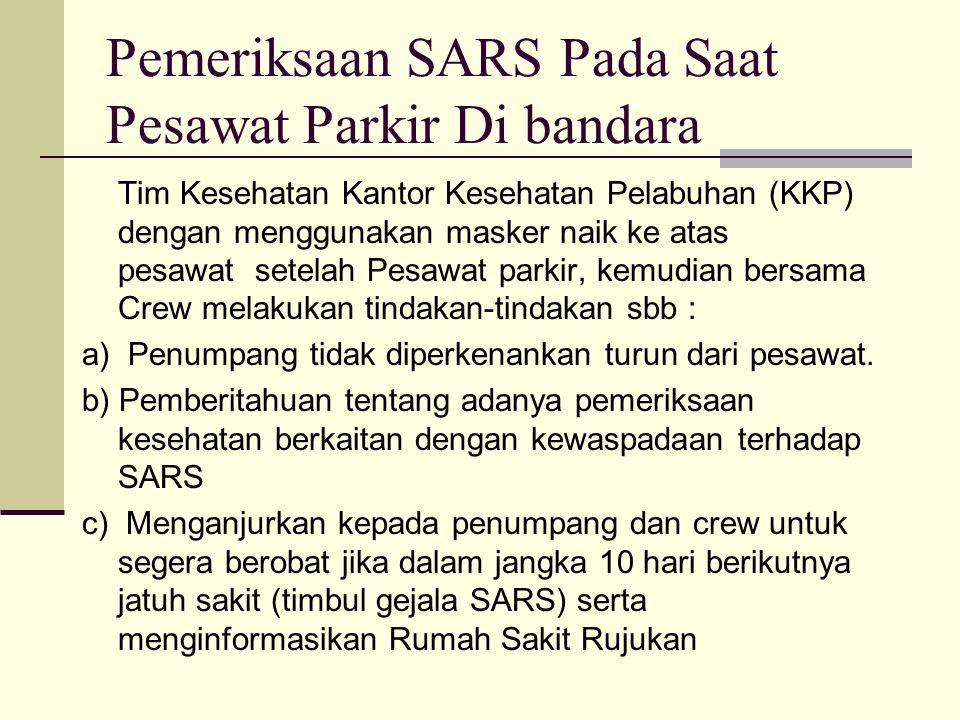 Pemeriksaan SARS Pada Saat Pesawat Parkir Di bandara Tim Kesehatan Kantor Kesehatan Pelabuhan (KKP) dengan menggunakan masker naik ke atas pesawat set