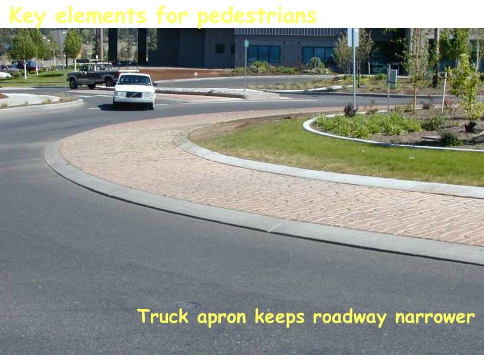Truck apron keeps roadway narrower Key elements for pedestrians