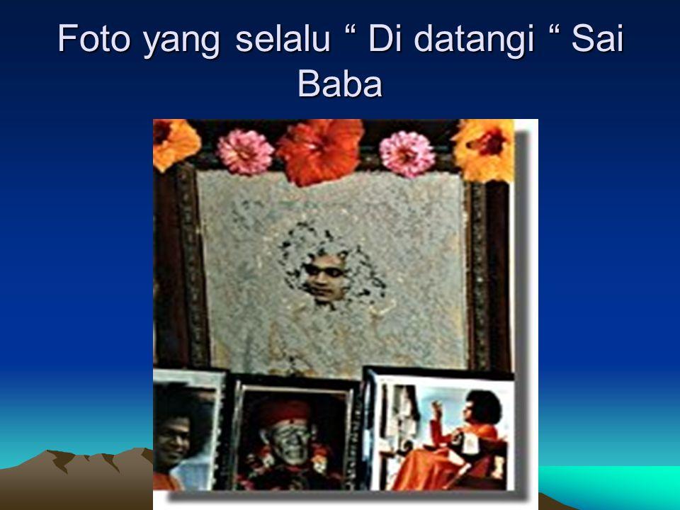 """TV yang selalu menyiarkan acara Sai Baba akan """" Di Datangi """" Sai Baba dalam bentuk Vibuthi / Tepung yang menempel"""