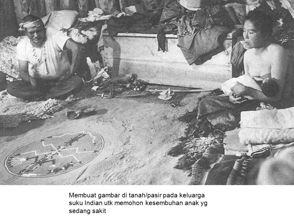 Membuat gambar di tanah/pasir pada keluarga suku Indian utk memohon kesembuhan anak yg sedang sakit