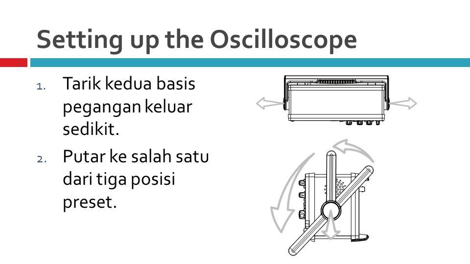 Setting up the Oscilloscope 1.Tarik kedua basis pegangan keluar sedikit.