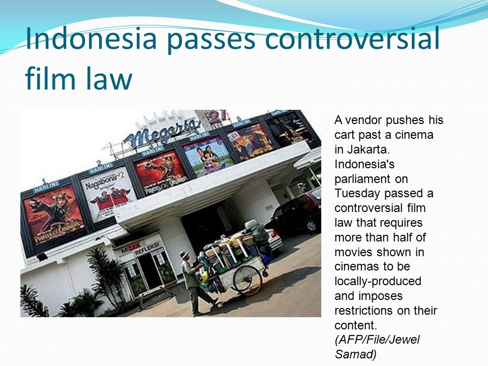 Indonesia passes controversial film law A vendor pushes his cart past a cinema in Jakarta. Indonesia's parliament on Tuesday passed a controversial fi