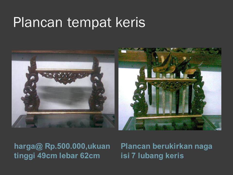 Plancan tempat keris harga@ Rp.500.000,ukuan tinggi 49cm lebar 62cm Plancan berukirkan naga isi 7 lubang keris