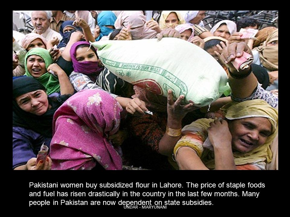 Pakistani women buy subsidized flour in Lahore.