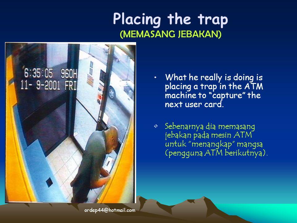 """What he really is doing is placing a trap in the ATM machine to """"capture"""" the next user card. Sebenarnya dia memasang jebakan pada mesin ATM untuk """"me"""