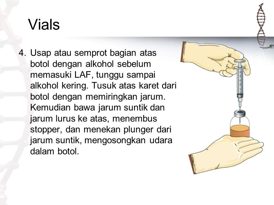 Vials 4.Usap atau semprot bagian atas botol dengan alkohol sebelum memasuki LAF, tunggu sampai alkohol kering. Tusuk atas karet dari botol dengan memi