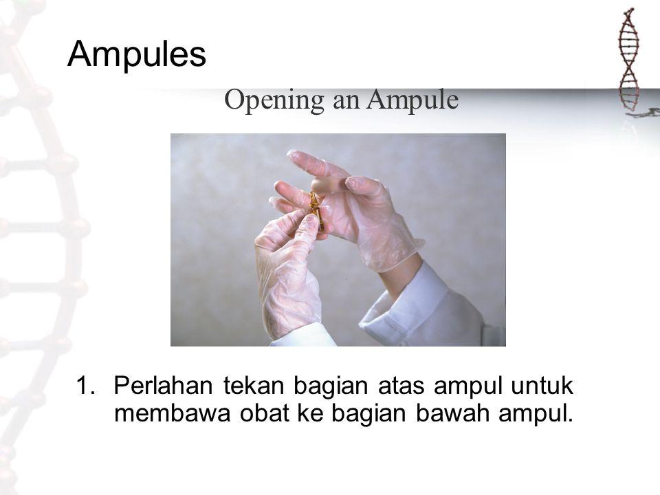 Ampules 1.Perlahan tekan bagian atas ampul untuk membawa obat ke bagian bawah ampul. Opening an Ampule