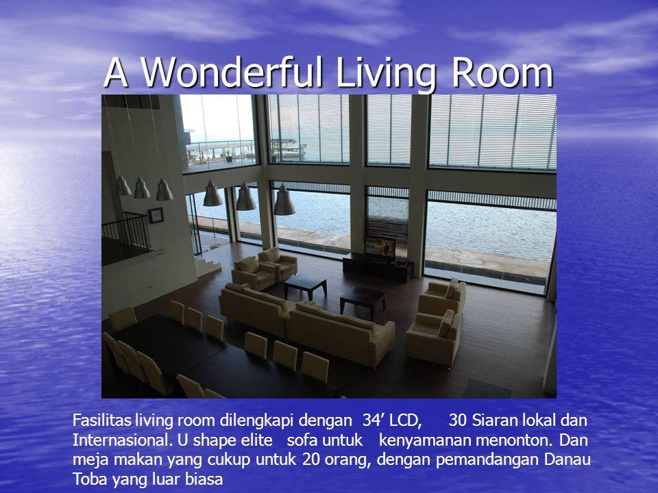 A Wonderful Living Room Fasilitas living room dilengkapi dengan 34' LCD, 30 Siaran lokal dan Internasional. U shape elite sofa untuk kenyamanan menont