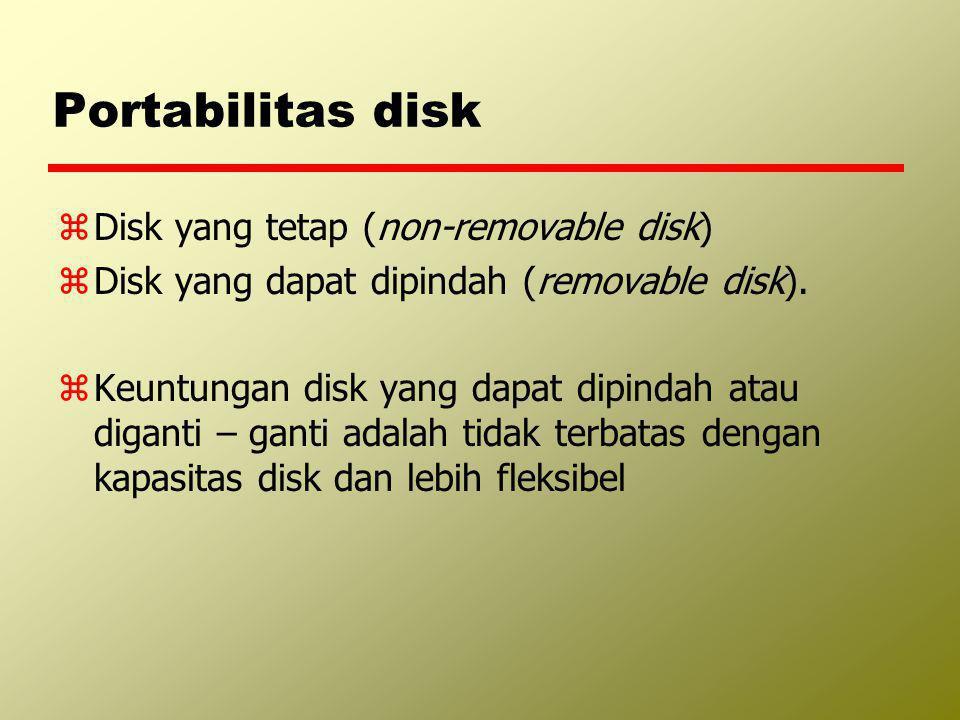 Portabilitas disk zDisk yang tetap (non-removable disk) zDisk yang dapat dipindah (removable disk). zKeuntungan disk yang dapat dipindah atau diganti