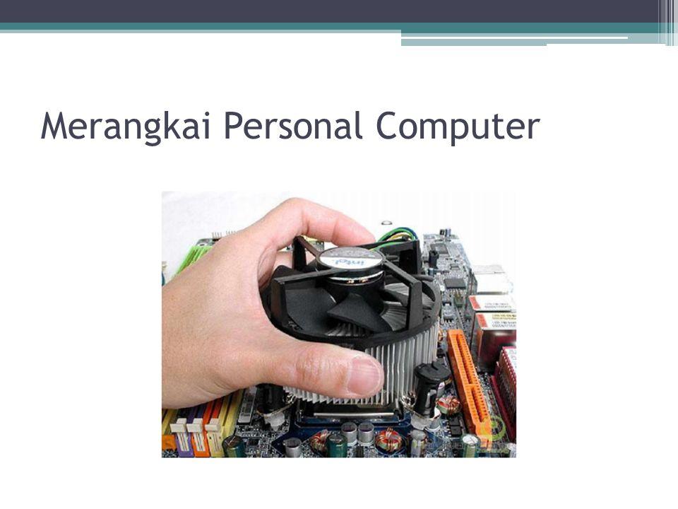 8.Sambungkan kabel pita (kabel data) pada dudukan hard disk, flopy drive dan CD ROM drive.