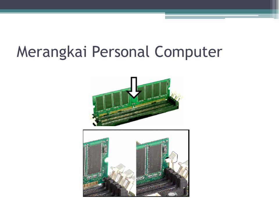 4.Masukan motherboard ke dalam cashing (kotak komputer), kaitkanlah pengait plastik yang biasa disediakan oleh pabrik cashing, ke dalam lubang yang terdapat pada motherboard.