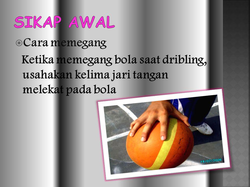  Cara memegang Ketika memegang bola saat dribling, usahakan kelima jari tangan melekat pada bola