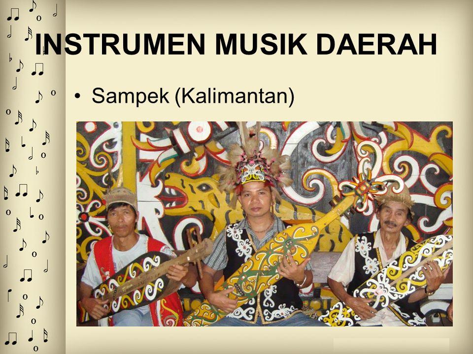 INSTRUMEN MUSIK DAERAH Alat musik yang terbuat dari kayu yang berbentuk busur seperti tanduk kerbau atau tanduk sapi yang bertumpu pada sebuah tempurung kelapa, di ujungnya atas bagian tanduk dipasang 1 buah senar dan dimainkan dengan cara dipetik Popondi (Toraja)