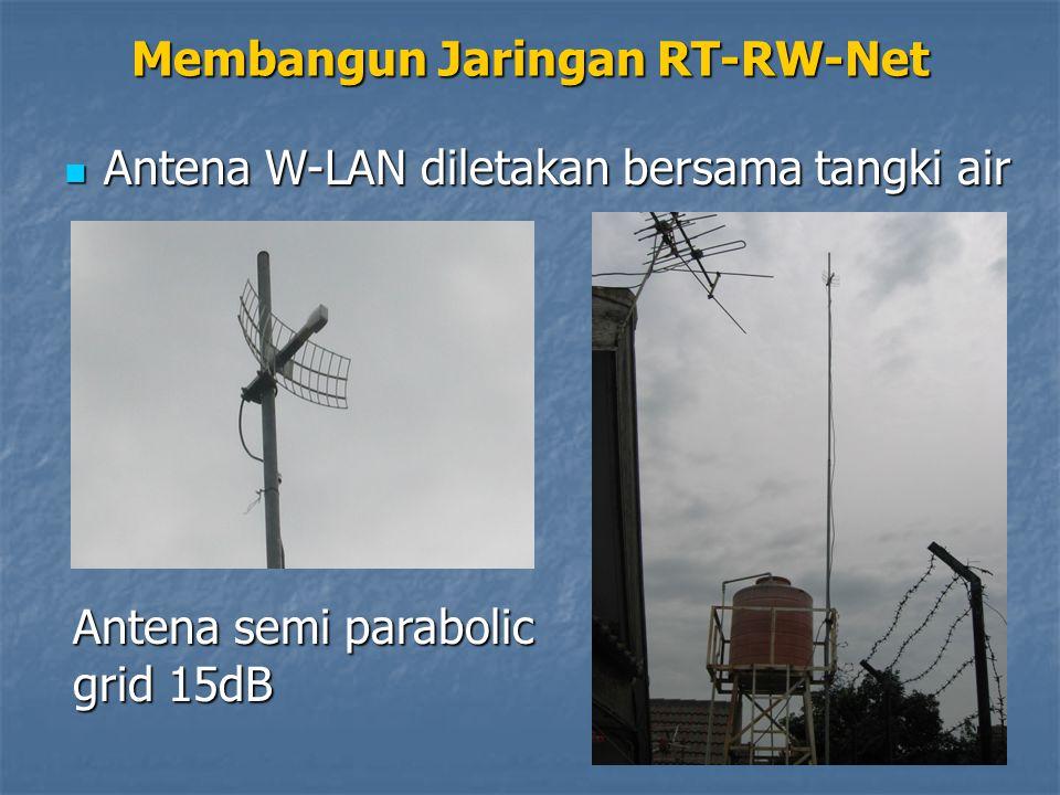 Membangun Jaringan RT-RW-Net Antena W-LAN diletakan bersama tangki air Antena W-LAN diletakan bersama tangki air Antena semi parabolic grid 15dB